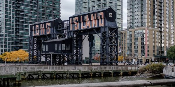 "A gantry that reads ""Long Island"" is seen from Gantry Plaza State Park in the Long Island City neighborhood in the Queens borough of New York, U.S., on Friday, Nov. 9, 2018. As reports emerged this week that Amazon.com Inc. was close to an agreement to set up a new office hub in Long Island City, the prospect of all those jobs, shoppers, and potential tenants or homebuyers drew cheers in the fast-growing neighborhood across the East River from Manhattan. Photographer: Christopher Lee/Bloomberg"
